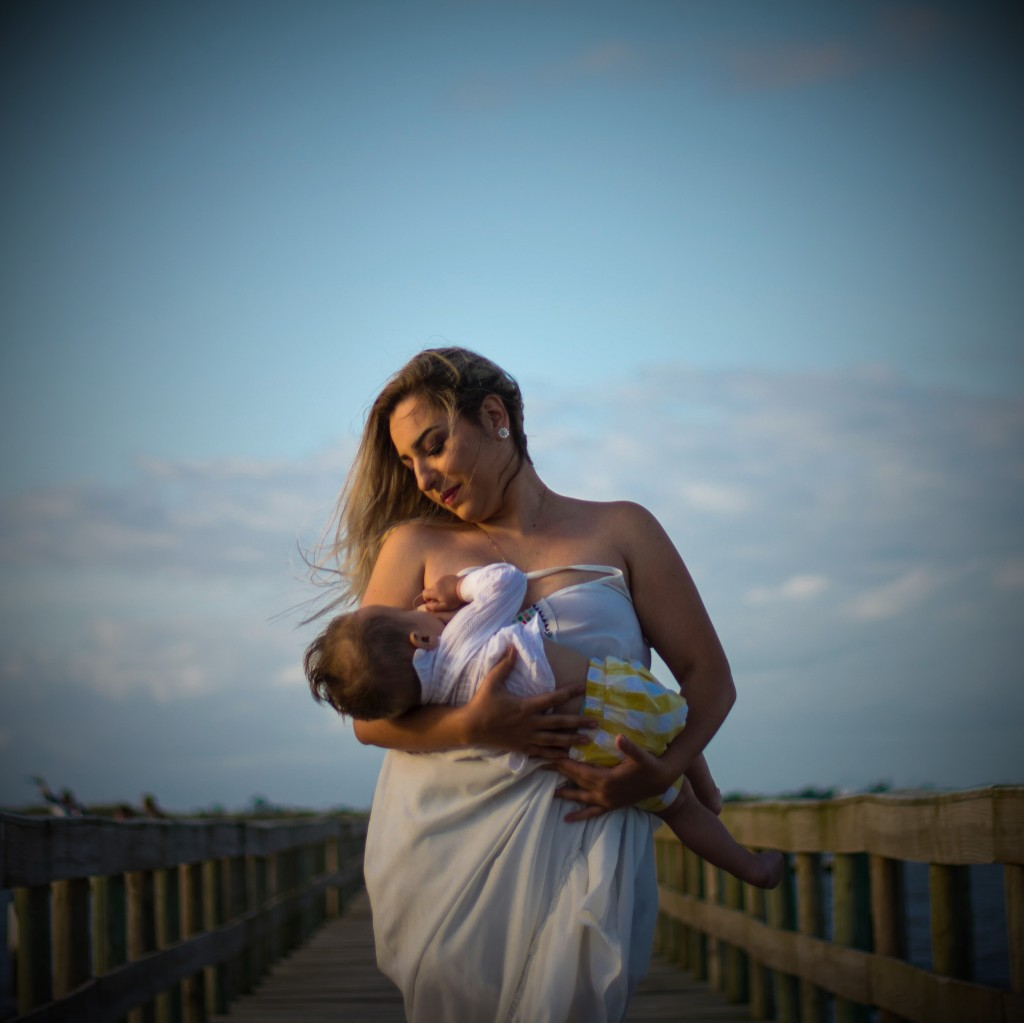 Woman Wearing White Dress Carrying Baby by Dalila Dalprat